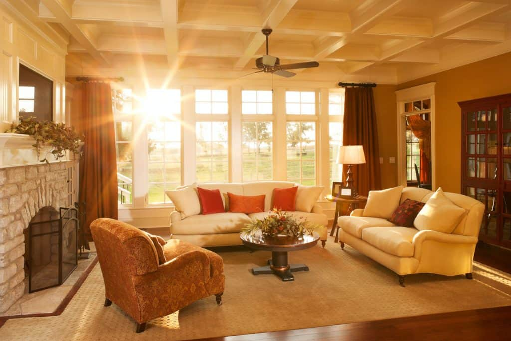 A traditional living room with direct sunlight