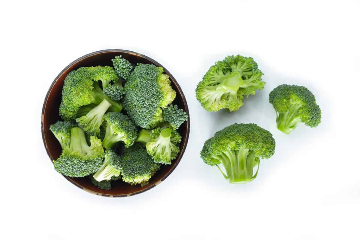 Pieces of sliced broccoli on a brown bowl